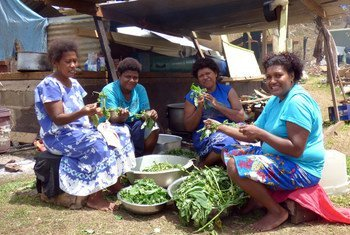 Mudu Village, Koro, Fiji, 2016: Vilisa Naivalubasaga, left, preparing donated food with a group of other women whose families have been left homeless by the cyclone on Koro.