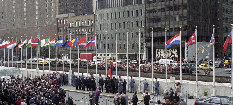 A view of the flag raising ceremony in March 1992 for the nine countries - Moldova, Kazakhstan, Kyrgyzstan, Azerbaijan, Uzbekistan, Tajikistan, Turkmenistan, Armenia and San Marino - admitted to the United Nations.