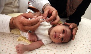 A nurse administers an immunization to a baby at a clinic in Ein Al Beidah, a village in northern West Bank.
