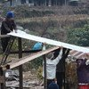 Corrugated iron sheets being used to create household shelter to protect survivors of the April 2015 earthquake in Nepal.