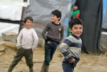 Syrian refugee children playing in their informal settlement at Al Faida, in the Bekaa Valley, Lebanon.