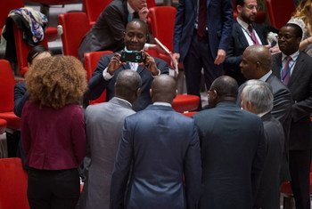 Members of Côte d'Ivoire's delegation pose for a group photo in the Security Council Chamber, where the mandate of the UN peacekeeping mission in that country (UNOCI) was renewed for a final period until 30 June 2017.