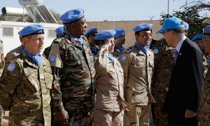 Secretary-General Ban Ki-moon (right) greets peacekeepers on 5 March 2016 during a military ceremony at the United Nations Mission for the Referendum in Western Sahara (MINURSO) Bir Lahlou site.