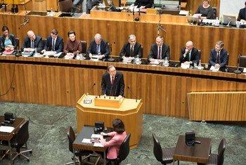 Secretary-General Ban Ki-moon (centre, at lectern) addresses the Austrian Parliament in Vienna.