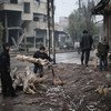 Two boys collect tree branches to make fire wood in Kafar Batna village in Rural Damascus, Syria.