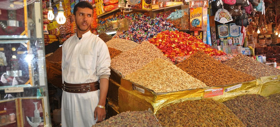 A vendor in his shop for selling nuts in old Sanaía city, Yemen.