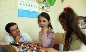 UNICEF Goodwill Ambassador Orlando Bloom plays Lego with pupils at a school in Slovyansk, as part of a visit to conflict-hit eastern Ukraine. He was in the country to raise awareness of the global education crisis facing children in emergencies. UNICEF/UN017899/Georgiev