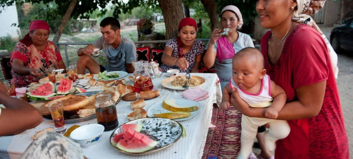 A family having a meal in Kyrgyzstan.