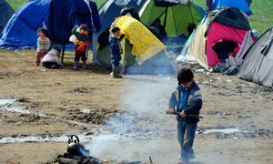 Children outside refugee tents on 8 March 2016, in Idomeni, Greece.