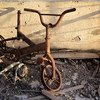 A bicycle, damaged by fire, sits on a third-floor balcony of a destroyed building, in the north-western city of Misrata, Libya.