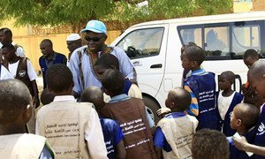 The African Union-UN Mission in Darfur (UNAMID) Sector West Child Protection Unit (CPU) at Krinding (1) Camp for internally displaced persons in El-Geneina, west Darfur, distributed vests inscribed with messages that promote the protection of children as part of its campaign.