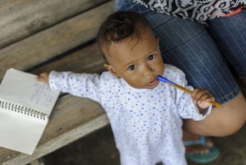 """One-year-old Ami Yin Silva at the San Jose de Chamanga shelter in Ecuador, which was built at an intersection that forms a """"Y"""" between the Troncal del Pac'fico highway and the entry road to San Jose de Chamanga Parish. UNICEF/UN018164/Reinoso"""