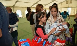 Refugee and migrant children receive recreational materials from the Hellenic Committee for UNICEF and partner Olympiacos Football Club, during a visit to the Eleonas Reception Centre in Athens, Greece.