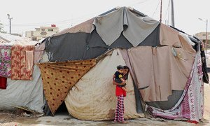The family living in this tent in Baghdad, Iraq, explained that the camp and the tents were not ready for winter. September 2015.