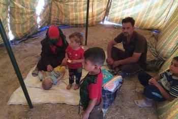 Cette famille a fui Falloujah avec seulement leurs vêtements sur le dos. Photo HCR/Semih Bulbul