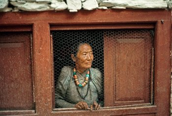 An old woman at her window in a Nepalese village.