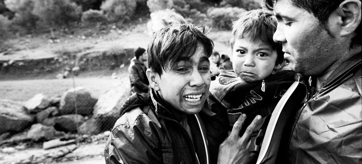 With fear etched on their faces, clearly still suffering from the trauma of a rough by boat across the Aegean, an Afghan family arrives in Lesbos, Greece (2015).