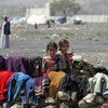 In Yemen, internally displaced children stand outside their family tent after the family fled their home in Saada province and found refuge in Darwin camp, in the northern province of Amran.