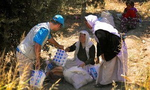 Unicef distributing water and hygiene items to Yazidi IDPs who crossed from Syria into Kurdistan, Iraq.