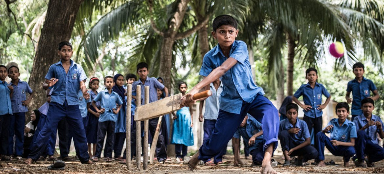 Rakib Hosain Sabbir, aged 9, a fourth grade student bats during a cricket game at Labsha Government Primary School in Satkhira Sadar, Bangladesh.