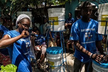As part of joint efforts between the UN and the Government of Haiti to fight cholera, water filter systems are distributed in Cité Soleil, Port au Prince.