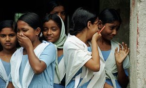 Students laugh as they leave school in Bangladesh.