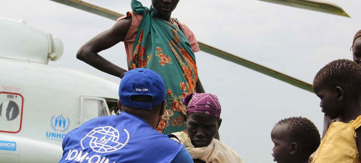 This photo from November 2014 shows IOM providing transportation assistance in South Sudan, moving vulnerable refugees on a UNHCR helicopter.