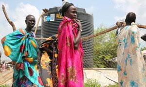 Women displaced by fighting in Juba, South Sudan, queue to fill containers with water after UNICEF delivered 100,000 litres of safe water to the site, where many residents had resorted drinking from a nearby stream. UNICEF/UN025202/Irwin