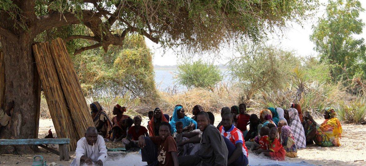 In Tagal, Chad, an IDP community meets under a tree. More than 100 persons had to flee from one of the small islands in Lake Chad after Boko Haram insurgents attacked their village.