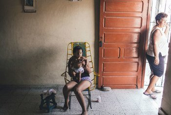 A mother and her daughter in Barranquilla, Colombia. National authorities are going door to door to control mosquitoes that can carry Zika, Dengue and Chikungunya.