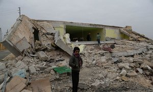 A child standing in front of his ground-flattened school after a bombardment in Ainjara village in rural Aleppo, Syria.