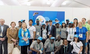 Secretary-General Ban Ki-moon (centre) meets with the Olympic Refugee Team at the Olympic Village in Rio de Janeiro, Brazil.