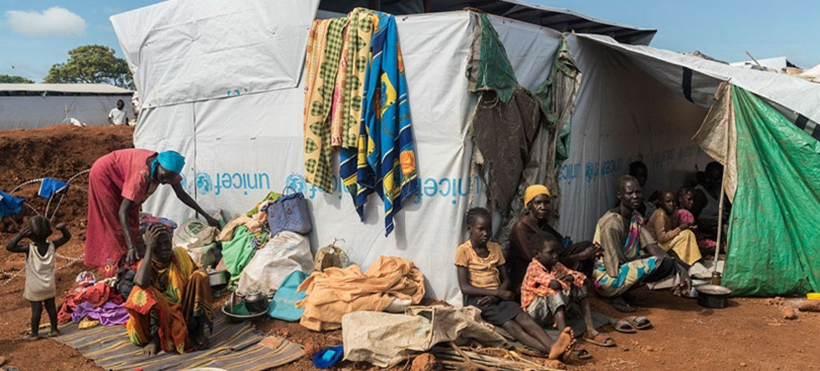 Families displaced by ongoing fighting seek shelter in the UN Protection of Civilians site in Wau, South Sudan.