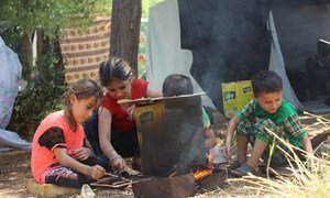 Children prepare a fire for cooking in Aleppo city, Syria. As of 2 August 2016, children are again facing terrible threats from new intense attacks and fighting in the western parts of the city.