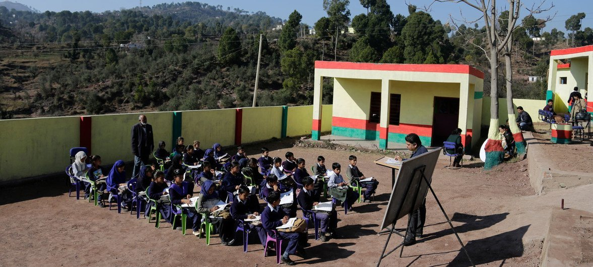 Children attend class in open at a government middle school, Rajouri district, Jammu and Kashmir, India.