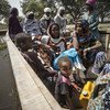 Wakikmbizi wa Nigeria wakiondoka katika kambi ya Ngouboua katika ufukwe wa ziwa Chad. Picha hii ilipigwa Februari 2015