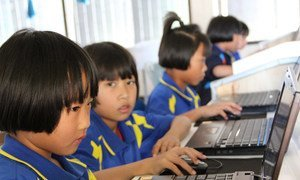 Young students learn their computer skills to prepare themselves for the future. Chiang Rai, Thailand, January 2012.