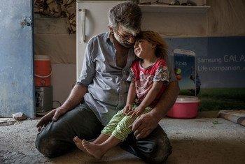Une famille déplacée de Mossoul vivant dans un camp dans les faubourgs d'Erbil, en Iraq. Photo HCR/Cingzir Yar