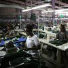 Young factory workers producing shirts in Accra, Ghana.