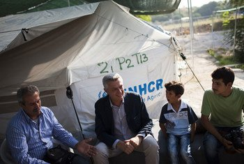 UN High Commissioner for Refugees Filippo Grandi (centre) talks with a Syrian family at the Lagkadikia site in Northern Greece.