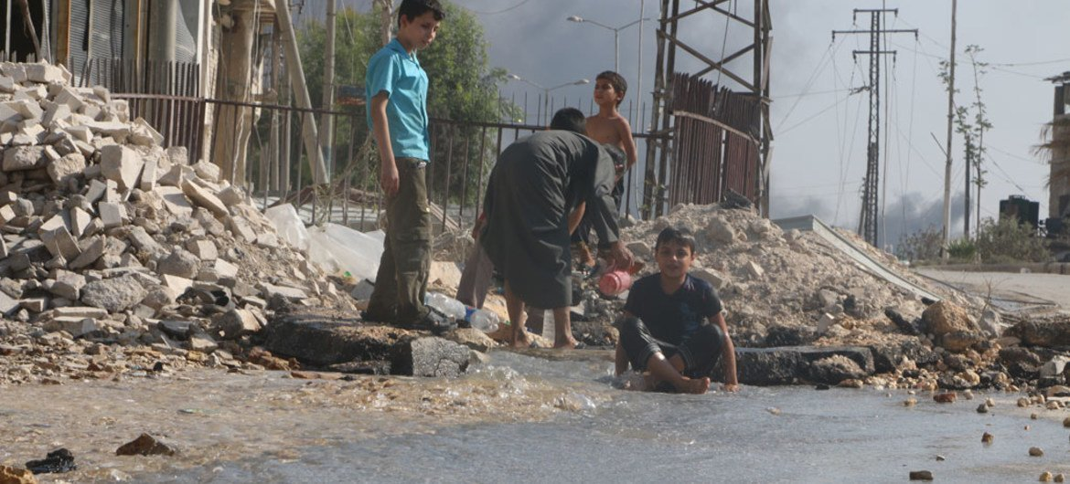 On 20 August 2016, children play near a broken water main, which was damaged by fighting in the Sheikh Saeed neighbourhood in eastern Aleppo, Syria.