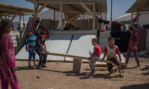 Children at play in a new extension in the Debaga Displacement Camp known as Debaga Two in Erbil Governorate, Iraq.