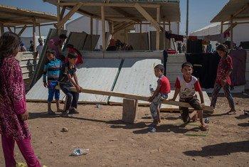 Des enfants dans un camp de déplacés dans le gouvernorat d'Erbil, en Iraq. Photo UNICEF/Lindsay Mackenzie