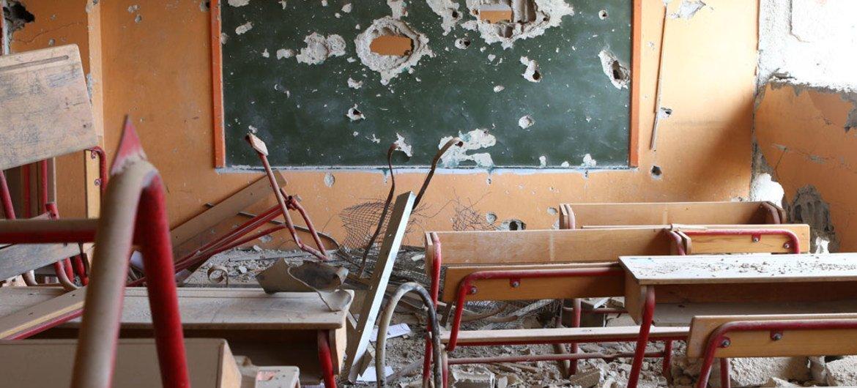 Une école primaire endommagée par les combats à Hujjaira, dans la région de Damas, en Syrie. Photo UNICEF/M. Abdulaziz