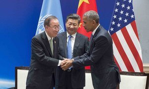 United Nations Secretary-General Ban Ki-moon shakes hands with China's President Xi Jinping and United States President Barack Obama at a climate pact ratification ceremony in Hangzhou, China, on 3 September 2016. China and the US deposited their legal instruments for formally joining the Paris Agreement.