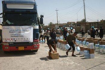 Le PAM distribue une assistance alimentaire à des milliers de personnes à Qayyarah, en Iraq. Photo Women Empowerment Organization (WEO)