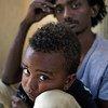 利比亚移民拘留中心。儿基会图片