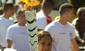 Adriana Almeida Santos, 15, carries the Olympic Flame in the city of Belém in state of Pará, Brazil.