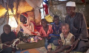 In  Diffa, Niger, a family uprooted from Malam Fatouri, Nigeria, by Boko Haram shelter at a site for displaced civilians on 18 August 2016.