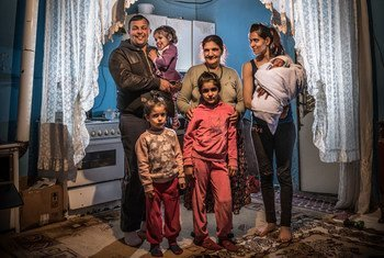 A family at home in a Roma settlement in Belgrade, Serbia.